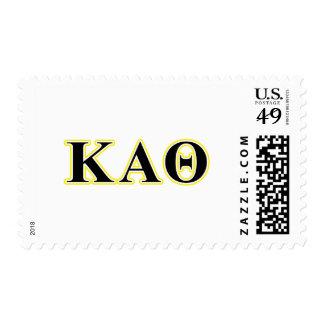 Letras amarillas y negras de la theta alfa de franqueo