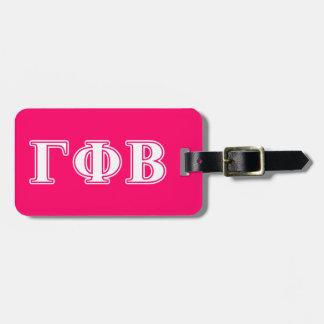 Letras blancas de la phi gamma y rosadas beta etiquetas para equipaje