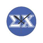 Letras blancas y azules de la ji de la sigma reloj de pared