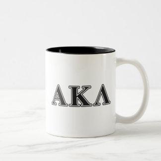 Letras blancas y púrpuras de la lambda alfa de taza de café de dos colores