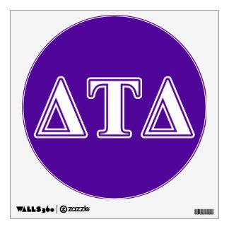 Letras blancas y púrpuras del delta del Tau del