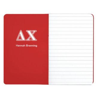 Letras blancas y rojas de la ji del delta cuaderno grapado
