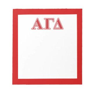 Letras blancas y verdes del delta gamma alfa bloc de papel
