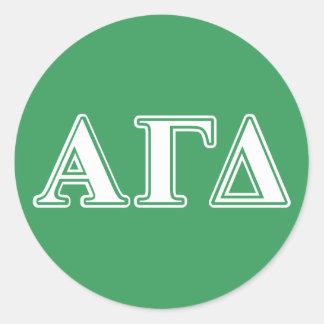 Letras blancas y verdes del delta gamma alfa pegatina redonda