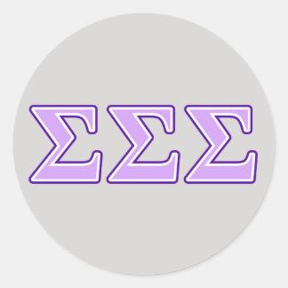 Letras de la púrpura y de la lavanda de la sigma pegatina redonda