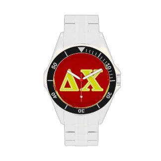 Letras del amarillo de la ji del delta relojes