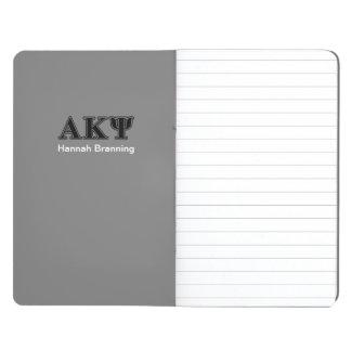 Letras negras alfa de Kappa PSI Cuadernos Grapados