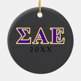 Letras púrpuras de la sigma y amarillas épsilones adorno navideño redondo de cerámica