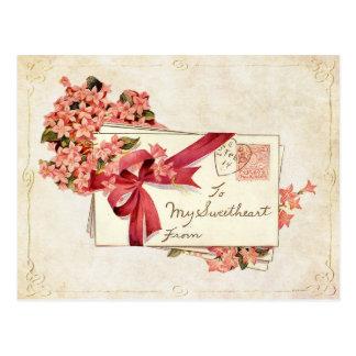 Letras y flores de amor de la tarjeta del día de S Postales