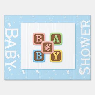 letter blocks on blue baby shower yard sign