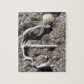 letter m in driftwood on florida beach jigsaw puzzle