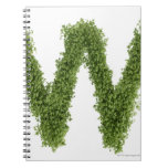 Letter 'W' in cress on white background, Spiral Notebook