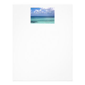 letterhead with photo of Belize coastline