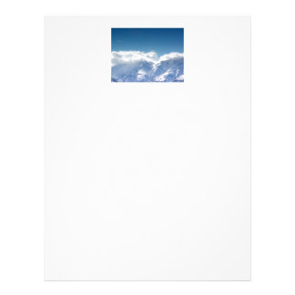 Letterhead with photo of snowy mountaintop