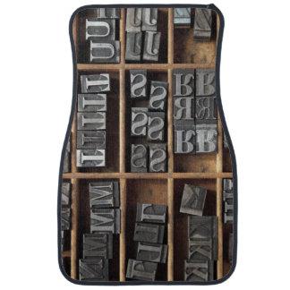 Letterpress lead type in a case car mat