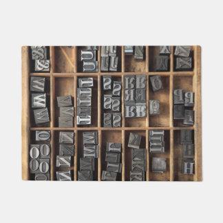 Letterpress lead type in a case doormat