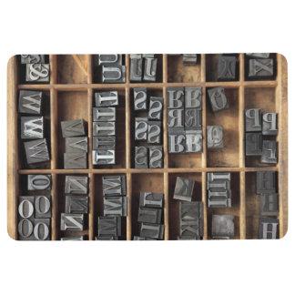 Letterpress lead type in a case floor mat