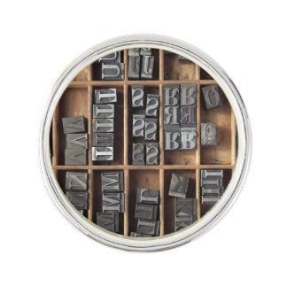 Letterpress lead type in a case lapel pin