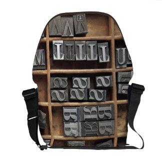 letterpress lead type in a case messenger bag
