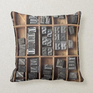letterpress lead type in a case throw pillow