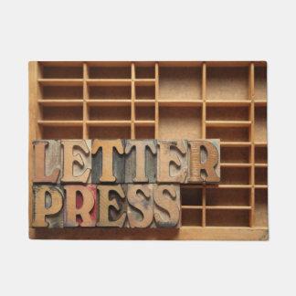 Letterpress word on type case doormat