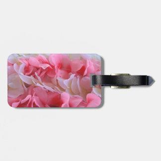 leus blancos rosados etiquetas de maletas