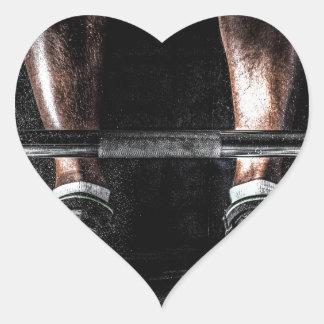 Levante los pesos pegatina en forma de corazón
