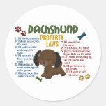 Leyes 4 de la propiedad del Dachshund Pegatina