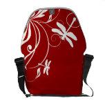 Libélula caprichosa roja y blanca bolsas de mensajería