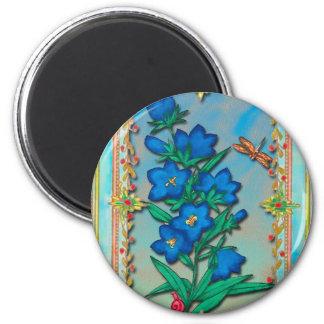 Libélula y flores azules imán