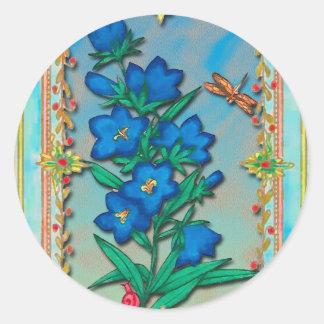 Libélula y flores azules pegatina