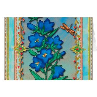 Libélula y flores azules tarjeton