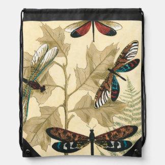 Libélulas coloridas que flotan sobre las hojas mochila