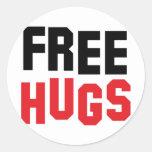 libere los abrazos etiquetas redondas