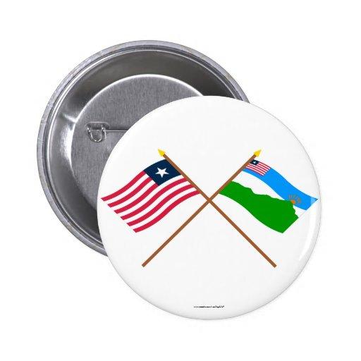 Liberia cruzado y banderas magníficas del condado  pins