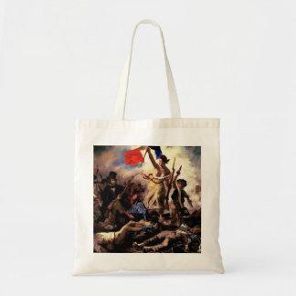 Libertad que lleva a la gente bolsas de mano