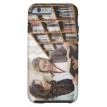 Librarian helping student with research in iPhone 6 case