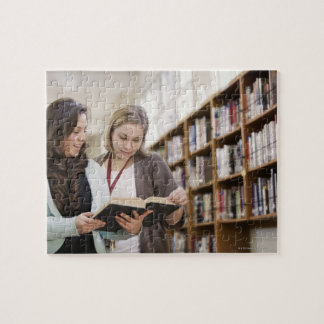 Librarian helping student with research in jigsaw puzzle