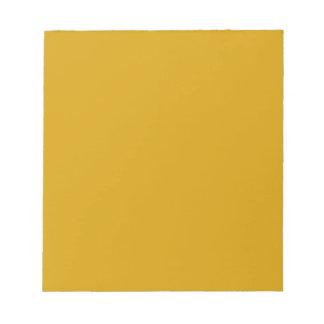 Libreta con el fondo amarillo de oro blocs de notas