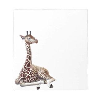 Libreta joven de la jirafa en descanso blocs