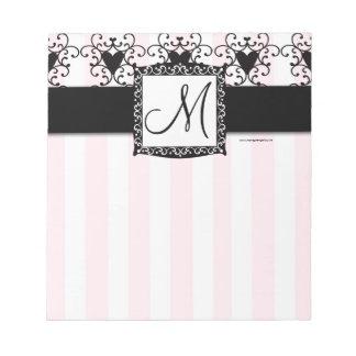 Libreta rosada de las rayas del monograma de los c blocs de papel