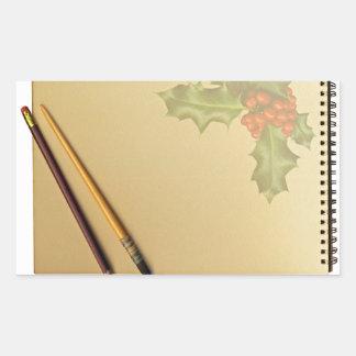 Libro de la mano con la pluma y el lápiz pegatina rectangular