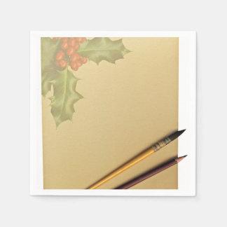 Libro de la mano con la pluma y el lápiz servilleta desechable