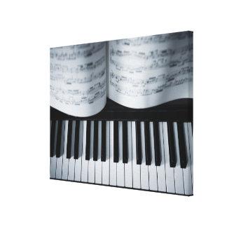 Libro de las llaves y de música del piano impresión en lona