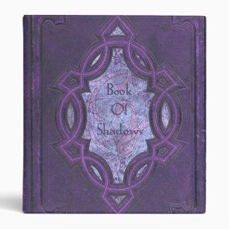 Libro púrpura del vintage de sombras
