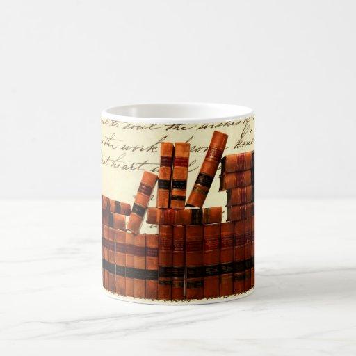 Libros de cuero antiguos tazas de café