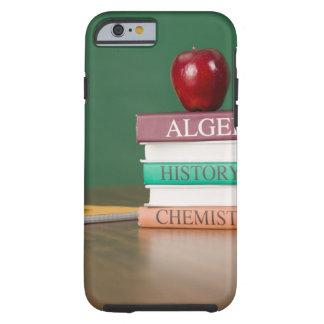 Libros de texto y funda de iPhone 6 tough