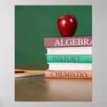 Libros de texto y una manzana posters