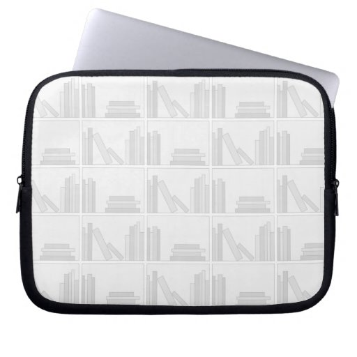 Libros grises pálidos en estante mangas portátiles