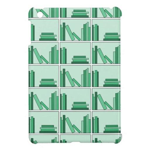 Libros verdes en estante